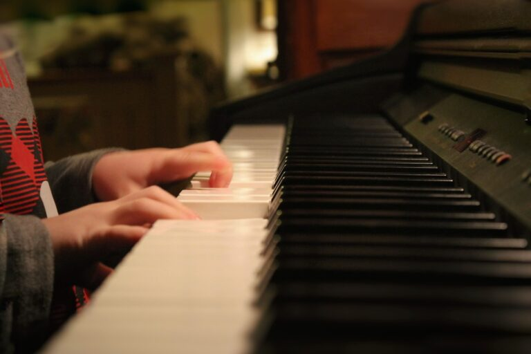 a pianist with small hands is playing piano