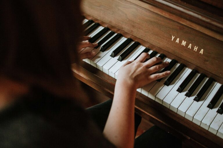 child playing an easy classical piano song on piano