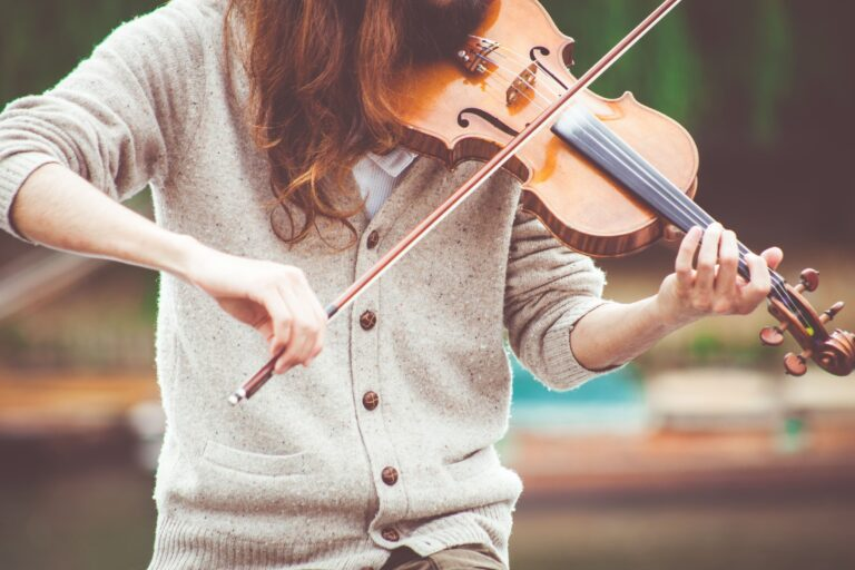 a violinist practicing songs that she chose