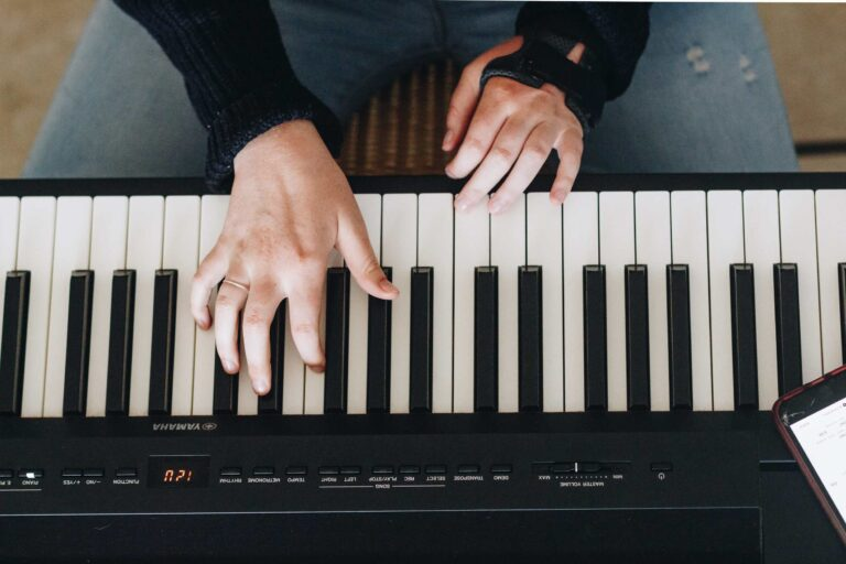 a piano player playing piano with both hands