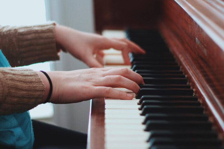 a beginner is learning piano scales
