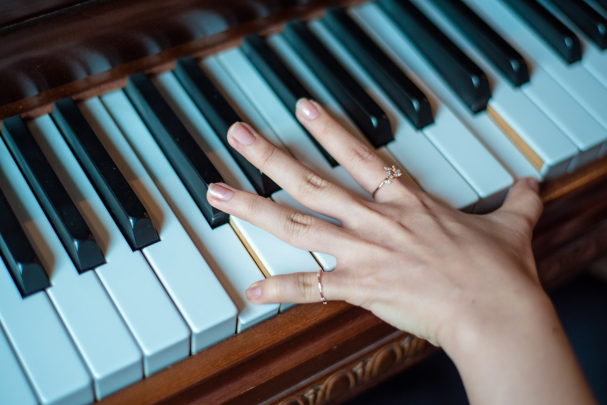 a beginner is playing easy one hand piano songs